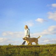 123-woman-walking-dog-on-grass300sq-medium_new